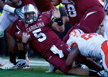 COLUMBIA, SC - NOVEMBER 28:  Stephen Garcia #5 of the South Carolina Gamecocks is tackled by Kevin Alexander #24 of the Clemson Tigers at Williams-Brice Stadium on November 28, 2009 in Columbia, South Carolina.  (Photo by Scott Halleran/Getty Images)