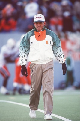 20 NOV 1993:  UNIVERSITY OF MIAMI HEAD COACH DENNIS ERICKSON WALKS OFF THE FIELD DURING THE HURRICANES 17-14 LOSS TO THE UNIVERSITY OF WEST VIRGINIA MOUNTAINEERS AT MOUNTAINEER FIELD IN MORGANTOWN, WEST VIRGINIA. Mandatory Credit: Doug Pensinger/ALLSPORT