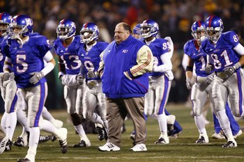 KANSAS CITY, MO - NOVEMBER 24: Coach Mark Mangino of the Kansas Jayhawks walks on the field with his team before the game against the Missouri Tigers at Arrowhead Stadium on November 24, 2007 in Kansas City, Missouri. (Photo by Jamie Squire/Getty Images)