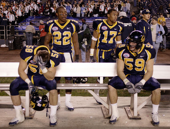 SAN DIEGO, CA - DECEMBER 30:  Linebacker Brian Tremblay #58, cornerbacks Tim Mixon #22, Randy Bundy #17, and linebacker Sid Slater #59 of the California Golden Bears appear dejected after their team's 45-31 loss to the Texas Tech Red Raiders in the Pacifi