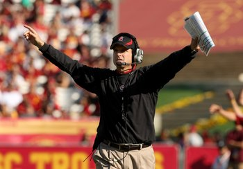 LOS ANGELES, CA - NOVEMBER 14:  Head coach Jim Harbaugh of the Stanford Cardinal signals during the game with the USC Trojans on November 14, 2009 at the Los Angeles Coliseum in Los Angeles, California.  Stanford won 55-21.  (Photo by Stephen Dunn/Getty I