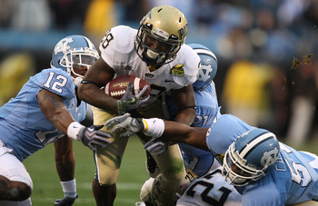 CHARLOTTE, NC - DECEMBER 26:  Dion Lewis #28 of the Pittsburgh Panthers runs with the ball against Charles Brown #12 of the North Carolina Tar Heels during their game on December 26, 2009 in Charlotte, North Carolina.  (Photo by Streeter Lecka/Getty Image