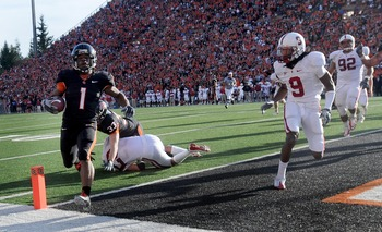 CORVALLIS, OR - OCTOBER 10: Running back Jacquizz Rodgers #1 of the Oregon State Beavers crosses the goal line for a touchdown as cornerback Richard Sherman #9 of the Stanford  Cardinals closes in during the second quarter of the game at Reser Stadium on