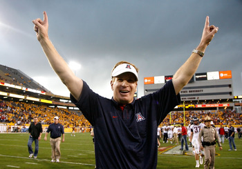 TEMPE, AZ - NOVEMBER 28:  Head coach Mike Stoops of the Arizona Wildcats celebrates after defeating the Arizona State Sun Devils in the college football game at Sun Devil Stadium on November 28, 2009 in Tempe, Arizona.  The Wildcats defeated the Sun Devil