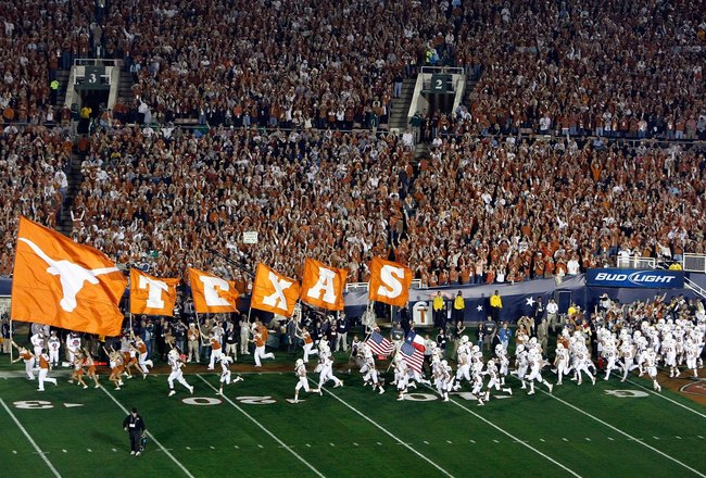 PASADENA, CA - JANUARY 07:  The Texas Longhorns run out onto the field prior to the Citi BCS National Championship game between the Texas Longhorns and the Alabama Crimson Tide at the Rose Bowl on January 7, 2010 in Pasadena, California.  (Photo by Jeff G