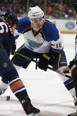 EDMONTON, CANADA - DECEMBER 21:  Jay McClement #18 of the St. Louis Blues looks to the linesman prior to taking the faceoff against Zack Stortini #46 of the Edmonton Oilers during their NHL game on December 21, 2009 at Rexall Place in Edmonton, Alberta, C