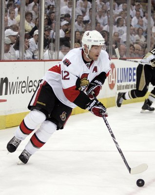 PITTSBURGH - APRIL 16:  Mike Fisher #12 of the Ottawa Senators handles the puck against the Pittsburgh Penguins in Game Two of the Eastern Conference Quarterfinals during the 2010 NHL Stanley Cup Playoffs at Mellon Arena on April 16, 2010 in Pittsburgh, P