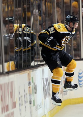 BOSTON - MAY 01:  Marc Savard #91 of the Boston Bruins celebrates his game winning goal in the overtime period against the Philadelphia Flyers in Game One of the Eastern Conference Semifinals during the 2010 NHL Stanley Cup Playoffs at TD Garden on May 1,