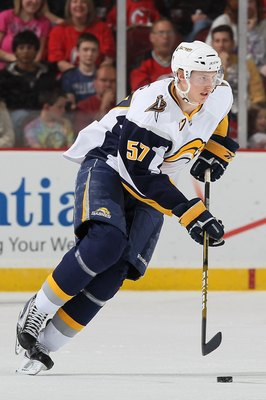 NEWARK, NJ - APRIL 11:  Tyler Myers #57 of the Buffalo Sabres attacks against the New Jersey Devils at the Prudential Center on April 11, 2010 in Newark, New Jersey.  (Photo by Chris McGrath/Getty Images)