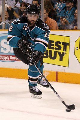 SAN JOSE, CA - MAY 18:  Patrick Marleau #12 of the San Jose Sharks moves the puck while taking on the Chicago Blackhawks in Game Two of the Western Conference Finals during the 2010 NHL Stanley Cup Playoffs at HP Pavilion on May 18, 2010 in San Jose, Cali