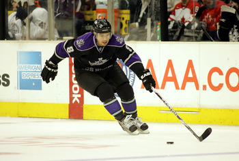 LOS ANGELES, CA - FEBRUARY 11:  Drew Doughty #8 of the Los Angeles Kings reaches with his stick to control the puck on his backhand in the neutral zone during their NHL game against the Edmonton Oilers at the Staples Center on February 11, 2010 in Los Ang