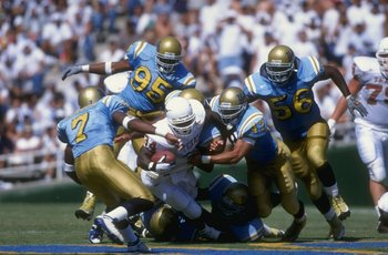 12 Sep 1998: Ricky Williams #34 of the Texas Longhorns grips the ball as he is tackled during the game against the UCLA Bruins at the Rose Bowl in Pasadena, California. UCLA defeated Texas 49-31.