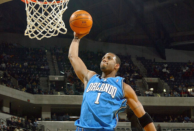 INDIANAPOLIS - DECEMBER 17:  Tracy McGrady #1 of the Orlando Magic dunks the ball against the Indiana Pacers on December17, 2003 at Conseco Fieldhouse in Indianapolis, Indiana. The Magic won 94-90.  (Photo by Andy Lyons/Getty Images)