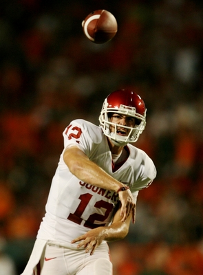 MIAMI GARDENS, FL - OCTOBER 3:   Quarterback Landry Jones #12 of the Oklahoma Sooners throws  the ball in the second quarter of the game against the Miami Hurricanes on October 3, 2009 at Landshark Stadium in Miami Gardens, Florida. (Photo by Doug Benc/Ge