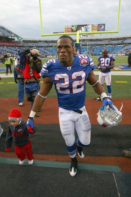 ORCHARD PARK, NY - NOVEMBER 29:  Fred Jackson #22 of the Buffalo Bills and his child walk off the field after the game against the Miami Dolphins at Ralph Wilson Stadium on November 29, 2009 in Orchard Park, New York. Buffalo won 31-14. (Photo by Rick Ste