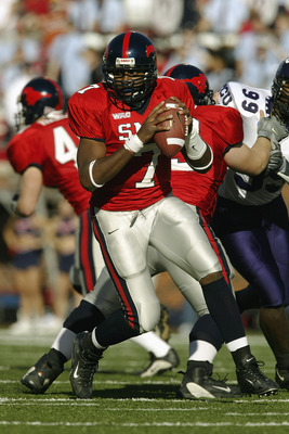 DALLAS - NOVEMBER 29:  Quarterback Chris Phillips #7 of the Southern Methodist University Mustangs runs out of the pocket against the Texas Christian University Horned Frogs on November 29, 2003 at Gerald J. Ford Stadium in Dallas, Texas. TCU won 20-13.