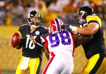 PITTSBURGH - AUGUST 29:  Quarterback Charlie Batch #16of the Pittsburgh Steelers is rushed as he looks to pass downfield in the third quarter during the game against the Buffalo Bills at Heinz Field on August 29, 2009 in Pittsburgh, Pennsylvania.(Photo by