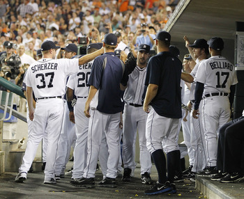 DETROIT - SEPTEMBER 02:  Justin Verlander #35 of the Detroit Tigers is congratulated by his teammates after  being removed from the game for a pitching change in the eighth inning against the Chicago White Sox at Comerica Park on September 2, 2011 in Detr