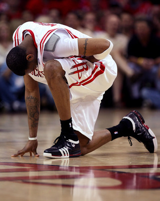 HOUSTON - APRIL 19:  Tracy McGrady #1 of the Houston Rockets kneels and holds his stomach after being fouled against the Utah Jazz in Game One of the Western Conference Quarterfinals during the 2008 NBA Playoffs at the Toyota Center on April 19, 2008 in H