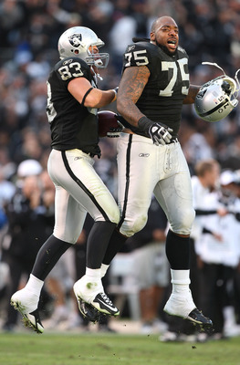 OAKLAND, CA - NOVEMBER 22:  Brandon Myers #83 of the Oakland Raiders celebrates with Mario Henderson #75 after defeating the Cincinnati Bengals during an NFL game at Oakland-Alameda County Coliseum on November 22, 2009 in Oakland, California.  (Photo by J
