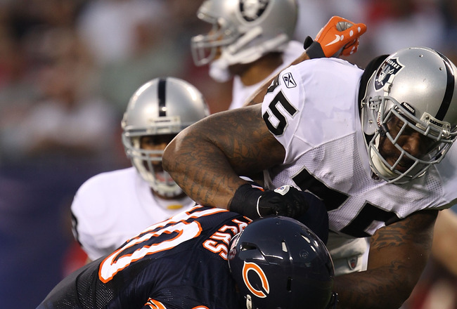 CHICAGO - AUGUST 21: Mario Henderson #75 of the Oakland Raiders blocks Julius Peppers #90 of the Chicago Bears during a preseason game at Soldier Field on August 21, 2010 in Chicago, Illinois. (Photo by Jonathan Daniel/Getty Images)