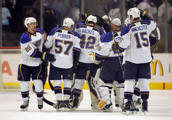 LOS ANGELES, CA - JANUARY 09:  Brad Boyes #22, David Perron #57, David Backes #42, backup goaltender Ty Conklin #29 and Brad Winchester #15 of the St. Louis Blues crowd around teammate goaltender Chris Mason #50 after they defeated the Los Angeles Kings 4
