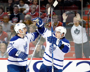 MONTREAL- APRIL 10:  Dion Phaneuf #3 celebrates his game winning goal with Francois Beauchemin #22 of the Toronto Maple Leafs during the NHL game on April 10, 2010 at the Bell Centre in Montreal, Quebec, Canada.  The Maple Leafs the Canadiens 4-3 in overt