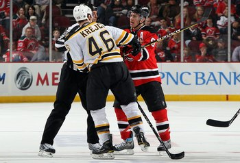 NEWARK, NJ - MARCH 30:  David Krejci #46 of the Boston Bruins skates against Zach Parise #9 of the New Jersey Devils at the Prudential Center on March 30, 2010 in Newark, New Jersey. The Bruins defeated the Devils 1-0 in overtime.  (Photo by Jim McIsaac/G