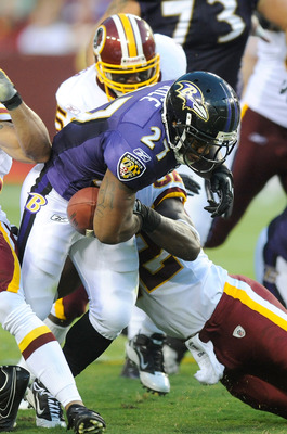 LANDOVER, MD - AUGUST 21:  Ray Rice #27 of the Baltimore Ravens fumbles the ball during the preseason game after a hit by Rocky McIntosh #52 of the Washington Redskins at FedExField on August 21, 2010 in Landover, Maryland.  (Photo by Greg Fiume/Getty Ima