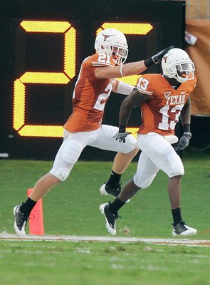 AUSTIN, TX - AUGUST 30: Ryan Palmer #13 of the Texas Longhorns is congratulated by  Blake Gideon #21 during the game against the Florida Atlantic Owls on August 30, 2007 at Darrell K Royal-Texas Memorial Stadium in Austin, Texas.  Texas won 52-10. (Photo