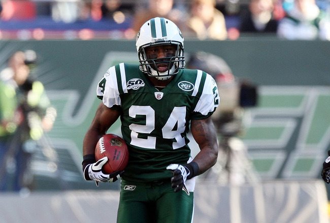 EAST RUTHERFORD, NJ - NOVEMBER 29:  Darrelle Revis #24 of the New York Jets runs the ball in for a first quarter touchdown after an interception against the Carolina Panthers on November 29, 2009 at Giants Stadium in East Rutherford, New Jersey.  (Photo b