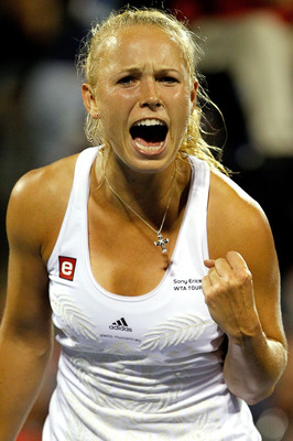MONTREAL, QC - AUGUST 19:  Caroline Wozniacki of Denmark celebrates winning a long rally against Flavia Pennetta of Italy during the Rogers Cup at Stade Uniprix on August 19, 2010 in Montreal, Canada.  (Photo by Matthew Stockman/Getty Images)