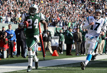 EAST RUTHERFORD, NJ - NOVEMBER 29:  Darrelle Revis #24 of the New York Jets runs the ball in for a first quarter touchdown after an interception against Jake Delhomme #17 of the Carolina Panthers on November 29, 2009 at Giants Stadium in East Rutherford,