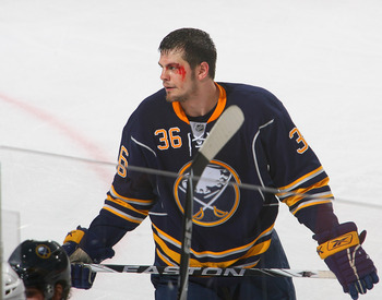 BUFFALO, NY - APRIL 15: Patrick Kaleta #36 of the Buffalo Sabres stands on the ice after being checked into the boards against the Boston Bruins in Game One of the Eastern Conference Quarterfinals during the 2010 NHL Stanley Cup Playoffs at HSBC Arena on