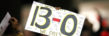 ATLANTA - DECEMBER 13:  A fan of the New Orleans Saints holds up a sign with '13-0' written on it during the game against the Atlanta Falcons at Georgia Dome on December 13, 2009 in Atlanta, Georgia. The Saints won 26-23. (Photo by Kevin C. Cox/Getty Imag