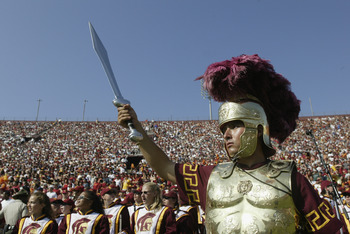 LOS ANGELES - SEPTEMBER 13:  A member of the University of Southern California Trojans marching band wears a soldier helmet and costume as he holds his sword in the air during the halftime performance at the game against the University of Hawaii Warriors