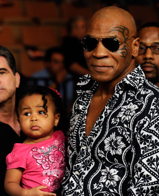 LAS VEGAS - JULY 31:  Mike Tyson holds his daughter Milan as he arrives at the  Juan Manuel Marquez and Juan Diaz bout at the Mandalay Bay Events Center July 31, 2010 in Las Vegas, Nevada.  (Photo by Ethan Miller/Getty Images)