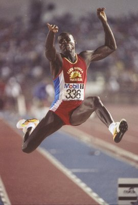 1992:  Carl Lewis is stretching his long jump at the U.S. Track and Field Trials in New Orleans, Louisiana. Mandatory Credit: Tony Duffy  /Allsport