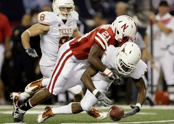 ARLINGTON, TX - DECEMBER 5:  Prince Amukamara #21 of the Nebraska Cornhuskers tackles James Kirkendoll #11 of the Texas Longhorns in the first quarter at Cowboys Stadium on December 5, 2009 in Arlington, Texas.  (Photo by Jamie Squire/Getty Images)