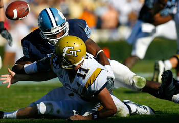 CHAPEL HILL, NC - NOVEMBER 08:  Quan Sturdivant #52 of the North Carolina Tar Heels forces a turnover with this fumble by quarterback Jaybo Shaw #11 of the Georgia Tech Yellow Jackets during the game at Kenan Stadium on November 8, 2008 in Chapel Hill, No