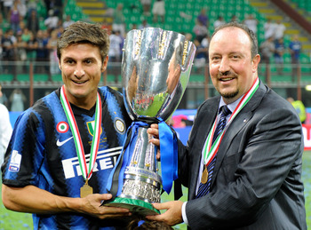 MILAN, ITALY - AUGUST 21:  Head Coach Rafael Benitez and Javier Zanetti of FC Internazionale Milano celebrate with the trophy after winning the Supercoppa Italiana match between Inter and Roma at Giuseppe Meazza Stadium on August 21, 2010 in Milan, Italy.