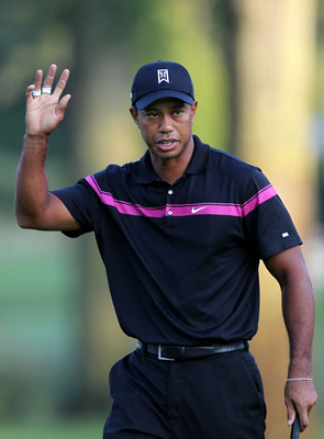 PARAMUS, NJ - AUGUST 26:  Tiger Woods reacts after he made a birdie putt on the first hole during the first round of The Barclays at the Ridgewood Country Club on August 26, 2010 in Paramus, New Jersey.  (Photo by Hunter Martin/Getty Images)