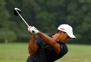 PARAMUS, NJ - AUGUST 25:  Tiger Woods hits a shot on the practice ground after the pro-am prior to the start of The Barclays at the Ridgewood Country Club on August 25, 2010 in Paramus, New Jersey.  (Photo by Scott Halleran/Getty Images)