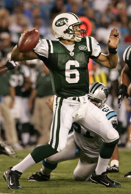 CHARLOTTE, NC - AUGUST 21:  Quarterback Mark Sanchez #6 of the New Yorks Jets throws under preasure from Derek Landri #61of the Carolina Panthers during their preseason game at Bank of America Stadium on August 21, 2010 in Charlotte, North Carolina. (Phot