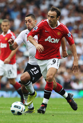 LONDON, ENGLAND - AUGUST 22:  Dimitar Berbatov of Manchester United takes on Clint Dempsey of Fulham during the Barclays Premier League match between Fulham and Manchester United at Craven Cottage on August 22, 2010 in London, England.  (Photo by Phil Col