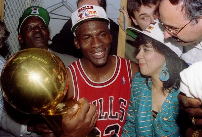 INGLEWOOD, CA - JUNE 12:  Guard Michael Jordan #23 of the Chicago Bulls sits nexts to his wife Juanita and his dad James while holding the NBA Championship Trophy after the Bulls defeated the Los Angeles Lakers 4-1 after Game 5 of the NBA Finals on June 1