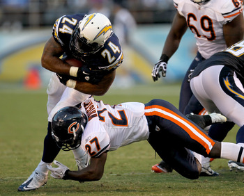 SAN DIEGO - AUGUST 14:  Running back Ryan Mathews #24 of the San Diego Chargers carries for a first down on fourth and one before being tackled by safety Major Wright #27 of the Chicago Bears on August 14, 2010 at Qualcomm Stadium in San Diego, California