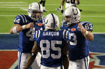 MIAMI GARDENS, FL - FEBRUARY 07:   Pierre Garcon #85 of the Indianapolis Colts celebrates after scoring a touchdown with Dallas Clark and Jeff Saturday #63 against the New Orleans Saints during Super Bowl XLIV on February 7, 2010 at Sun Life Stadium in Mi