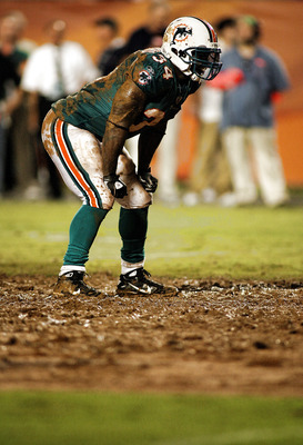 MIAMI - AUGUST 14:  Running back Ricky Williams #34 rushes against the Tampa Bay Buccaneers during the preseason game at Sun Life Stadium on August 14, 2010 in Miami, Florida.  (Photo by Marc Serota/Getty Images)