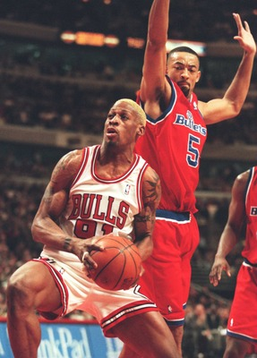 13 Mar 1996:  Foward DennisRodman #91 of the Chicago Bulls attempts to manuever for an open shot while forward  Juwan Howard of the Washington Bullets attempts to block shot during the Bulls game against the Bullets at the United Center in Chicago, Illino